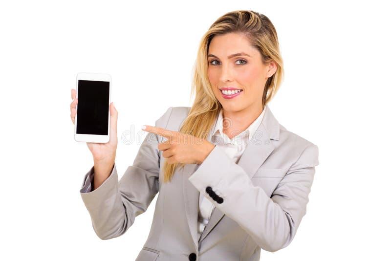 指向电话的女实业家 免版税库存照片