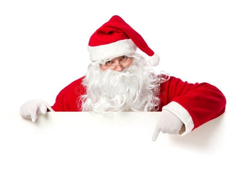 指向空白横幅的圣诞老人 免版税库存图片