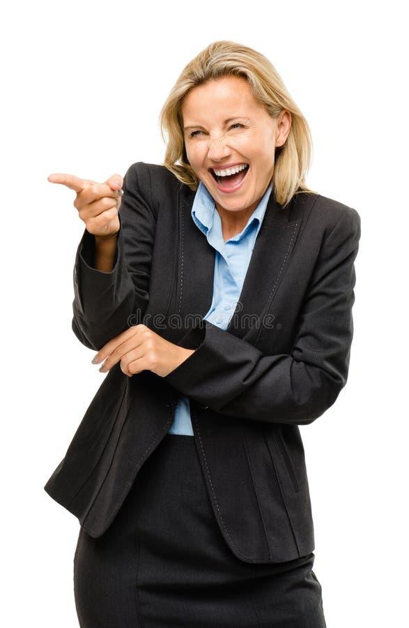 指向笑的愉快的成熟的商业妇女是傻的isolat 库存照片