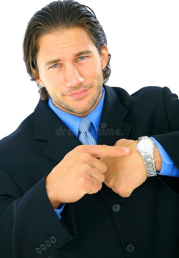 指向翻倒手表的生意人 免版税库存照片