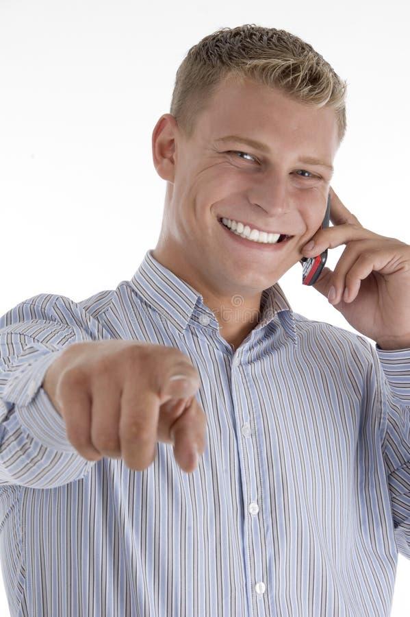 指向联系的人移动电话 库存图片