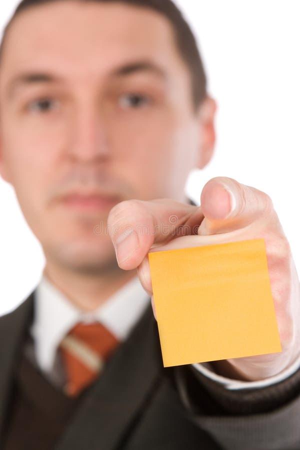 指向贴纸的生意人 免版税图库摄影