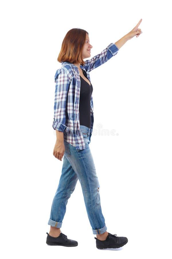 指向走的妇女后面看法  免版税库存图片
