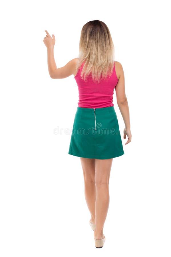 指向走的妇女后面看法  免版税库存照片