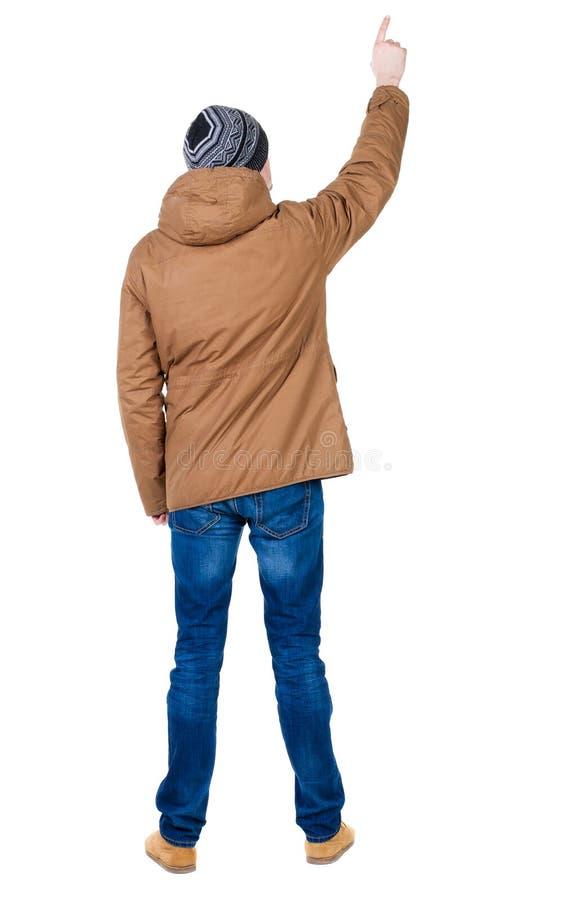 指向附头巾皮外衣的年轻人后面看法  库存图片