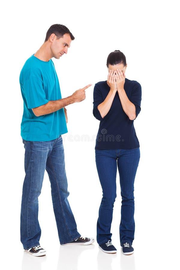 指向女朋友的男朋友 免版税库存照片