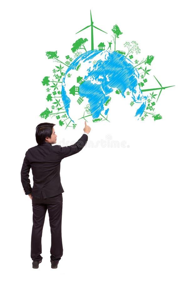 指向绿色生态概念的商人 库存图片