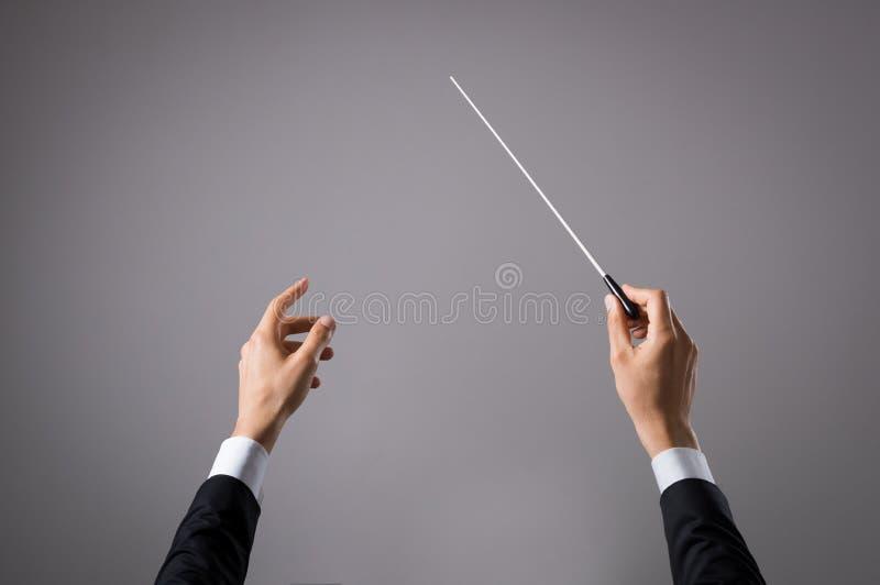 指挥音乐会的音乐家 免版税图库摄影