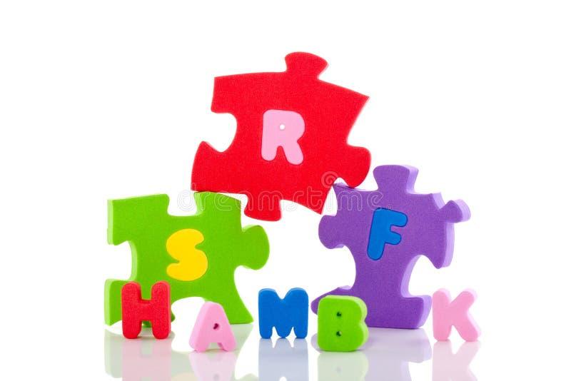 按字母的五颜六色的难题 免版税库存照片