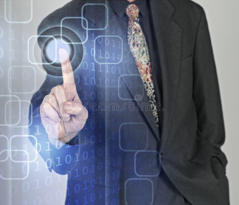 按按钮的生意人 免版税库存照片