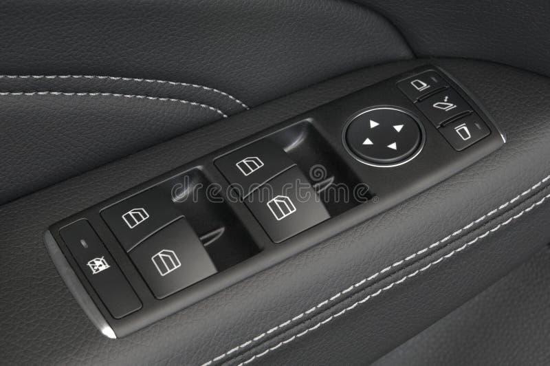 按汽车严密控制门面板  库存图片