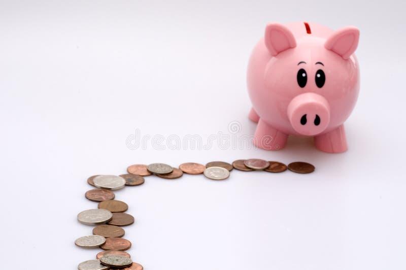 按照贪心线索的银行硬币 免版税库存照片