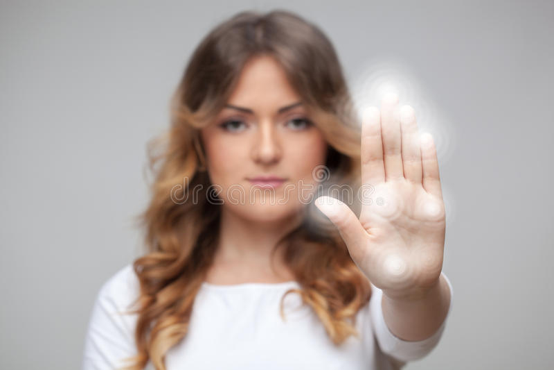 按触摸屏幕按钮的妇女 库存图片