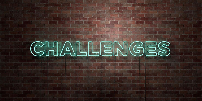 挑战-在砖砌的萤光氖灯标志-正面图- 3D回报了皇族自由储蓄图片 库存例证