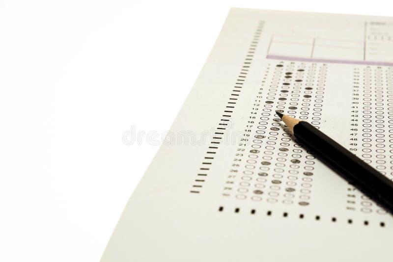 挑选答案纸和铅笔 库存照片