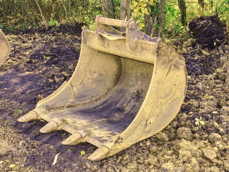 挖掘机的挖掘机桶推土机 履带牵引装置挖掘机铁锹 库存照片