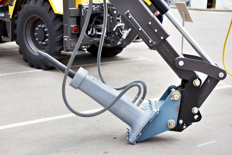 挖掘机附件水力破碎机 免版税库存照片