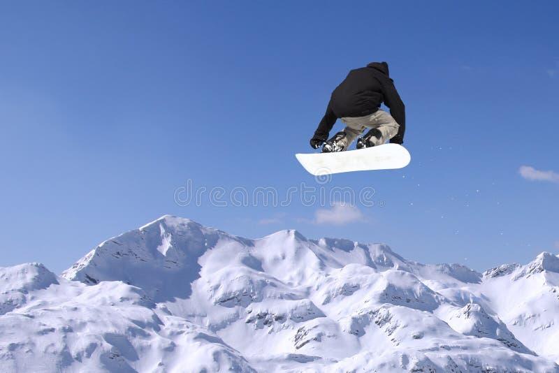 挡雪板跳跃 免版税库存图片