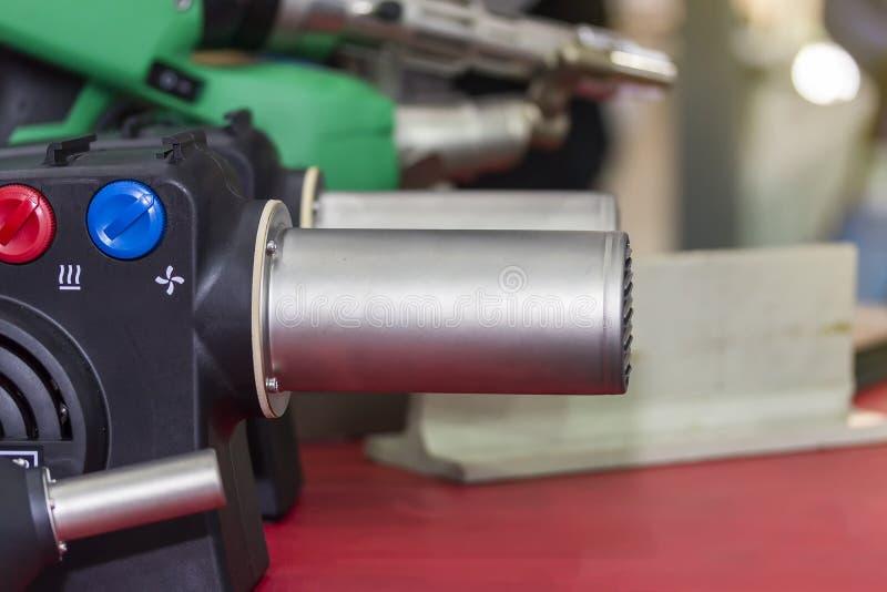 挤压机塑料焊接器的关闭工业修理和维护的 免版税图库摄影