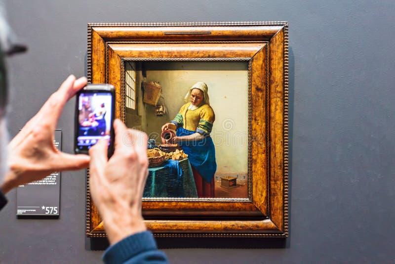 挤奶的妇女的油画荷兰Ri的扬・弗美尔 库存照片