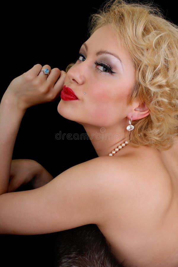 挥动在妇女的黑色blondie 免版税图库摄影