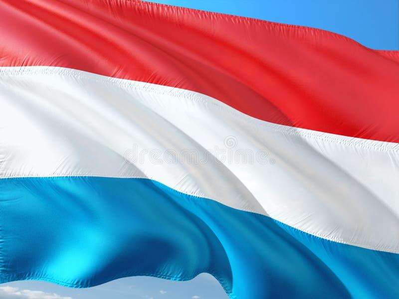 挥动在风的卢森堡旗子反对深天空蔚蓝 r 图库摄影