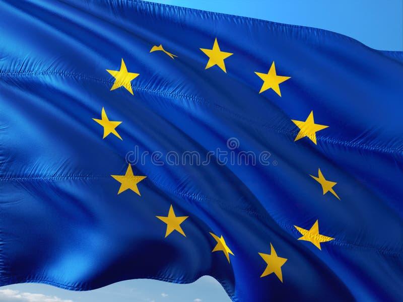 挥动在风的欧盟旗子反对深天空蔚蓝 优质织品 库存照片