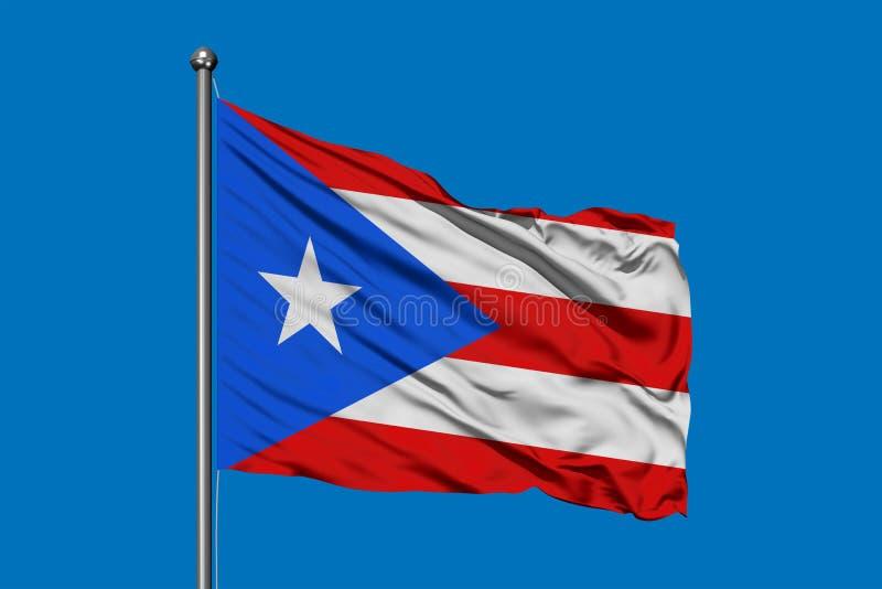 挥动在风的波多黎各的旗子反对深天空蔚蓝 图库摄影
