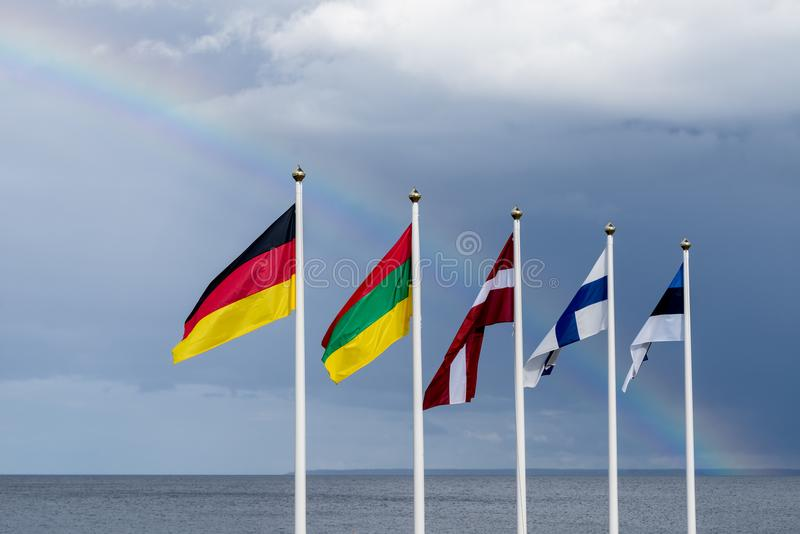 挥动在风的爱沙尼亚语,芬兰,立陶宛,拉脱维亚和德国旗子 库存照片