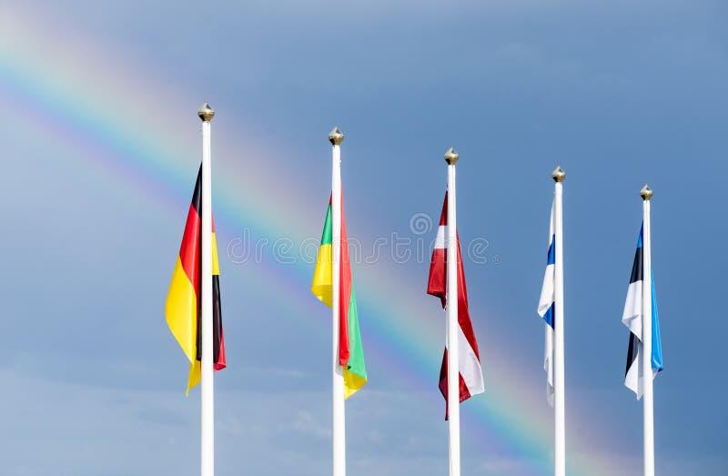 挥动在风的爱沙尼亚语,芬兰,立陶宛,拉脱维亚和德国旗子 库存图片