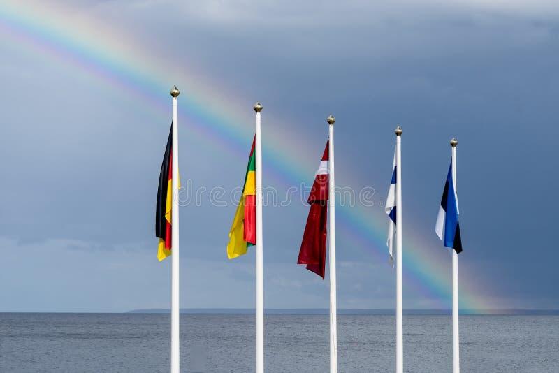 挥动在风的爱沙尼亚语,芬兰,立陶宛,拉脱维亚和德国旗子 免版税库存图片