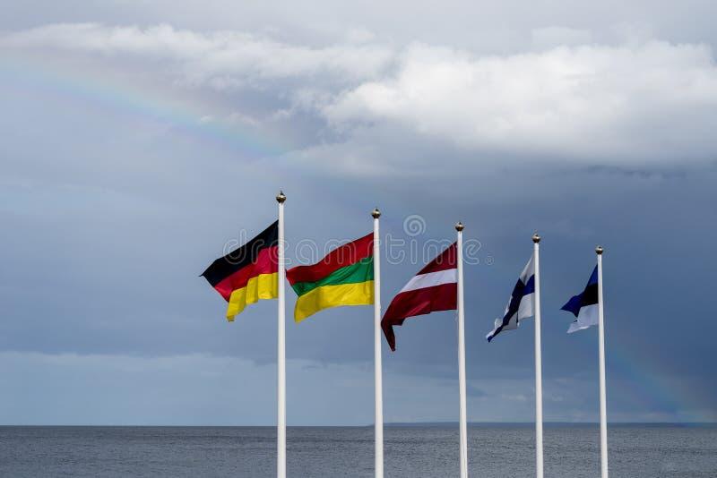 挥动在风的爱沙尼亚语,芬兰,立陶宛,拉脱维亚和德国旗子 免版税库存照片