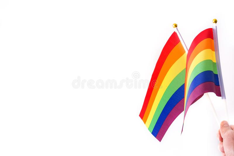 挥动快乐旗子的手隔绝在白色背景 库存照片