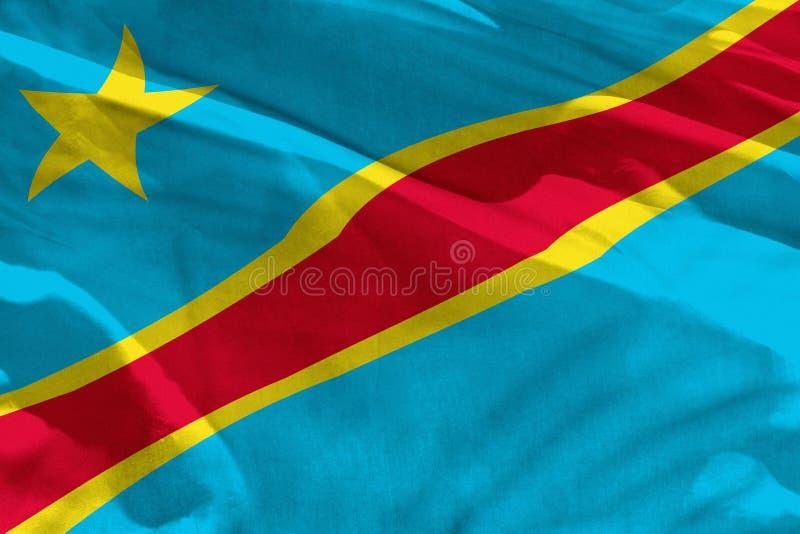 挥动的刚果民主共和国旗子为使用作为纹理或背景,旗子在风振翼 皇族释放例证
