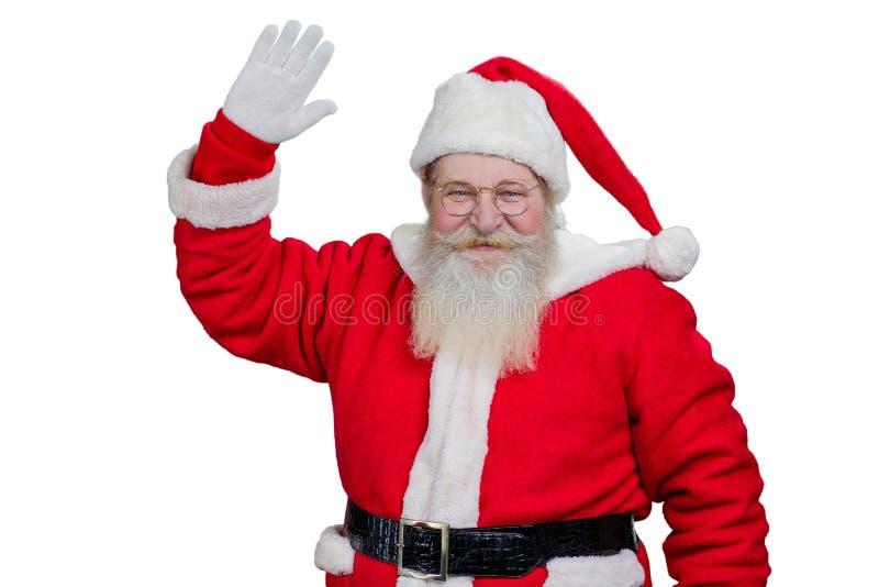挥动的圣诞老人微笑和 免版税库存照片