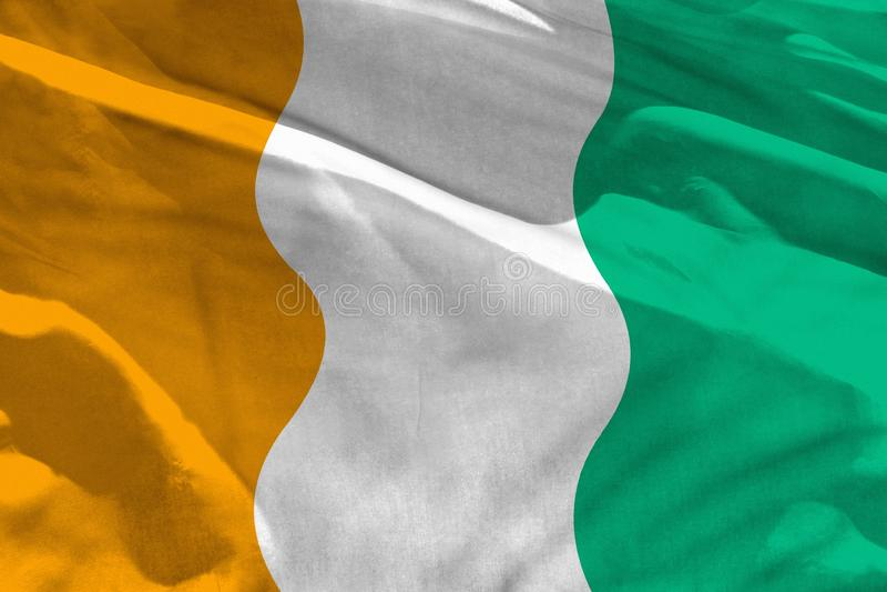 挥动的彻特d Ivoire旗子为使用作为纹理或背景,旗子在风振翼 库存例证