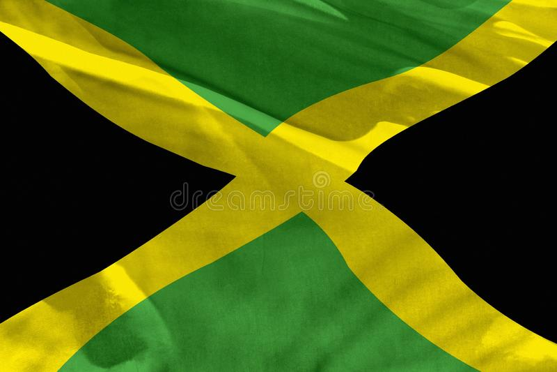挥动的牙买加旗子为使用作为纹理或背景,旗子在风振翼 皇族释放例证