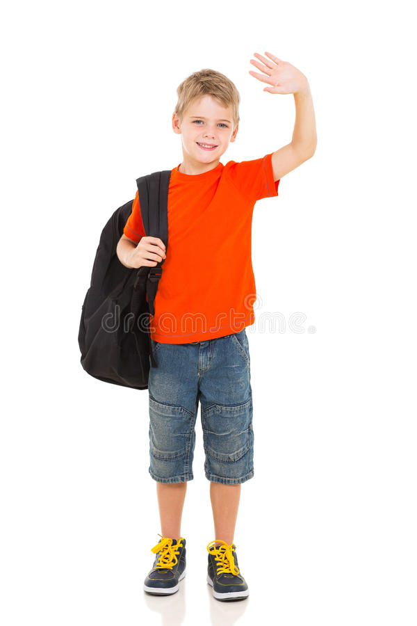 挥动的男小学生再见 免版税库存图片