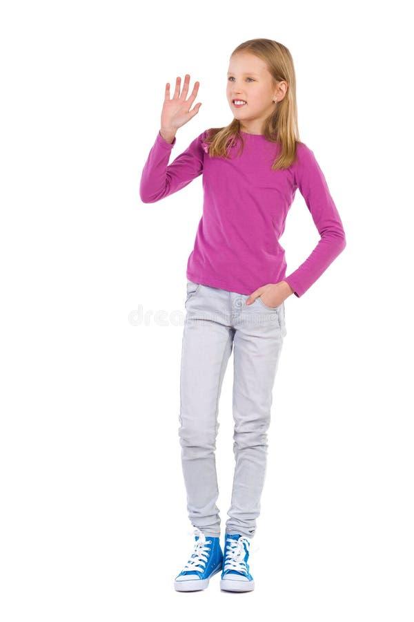 挥动的白肤金发的女孩 库存图片
