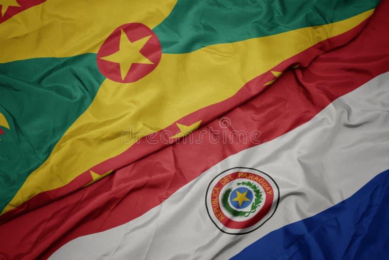 挥舞着彩色的巴拉圭国旗和格林纳达国旗 免版税库存图片