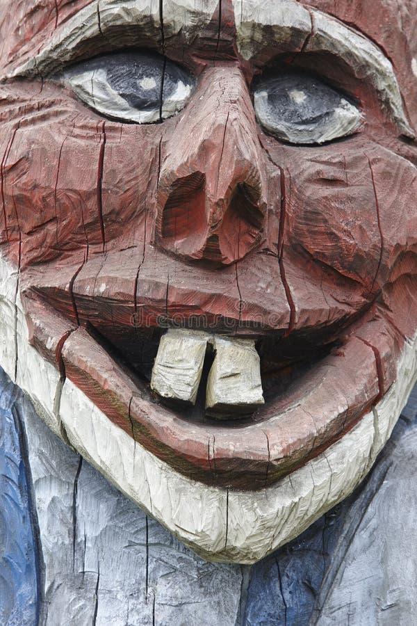 挪威语被雕刻的木面孔细节拖钓 斯堪的纳维亚民间传说 库存图片