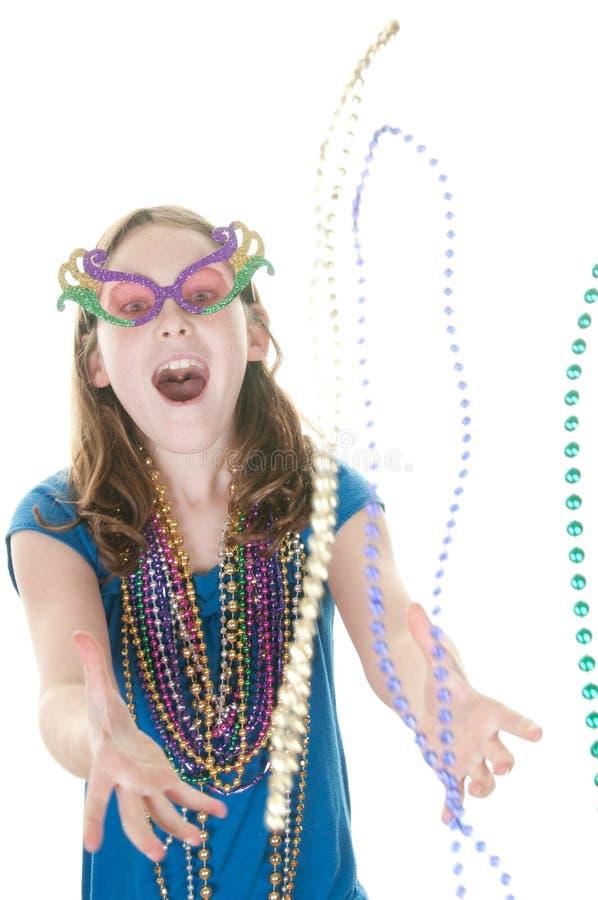 捉住女孩gras mardi的小珠 免版税库存照片