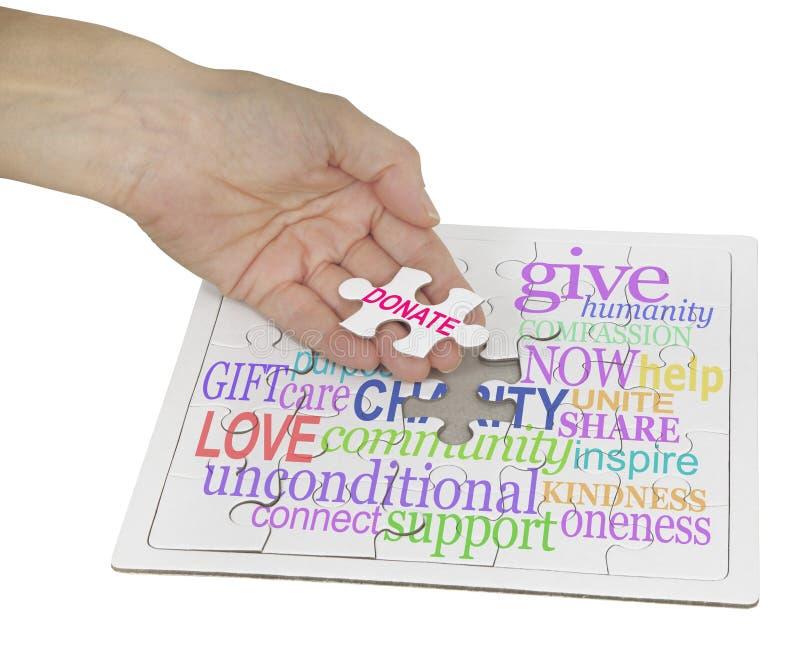 捐赠对慈善难题 免版税图库摄影
