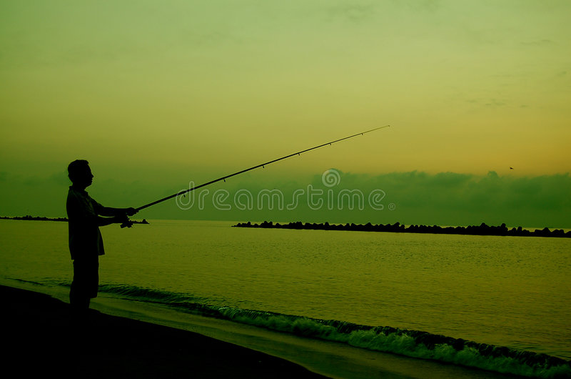 捕鱼剪影 库存照片