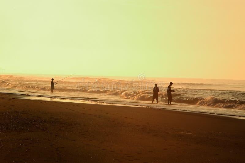 捕鱼海浪 免版税库存照片