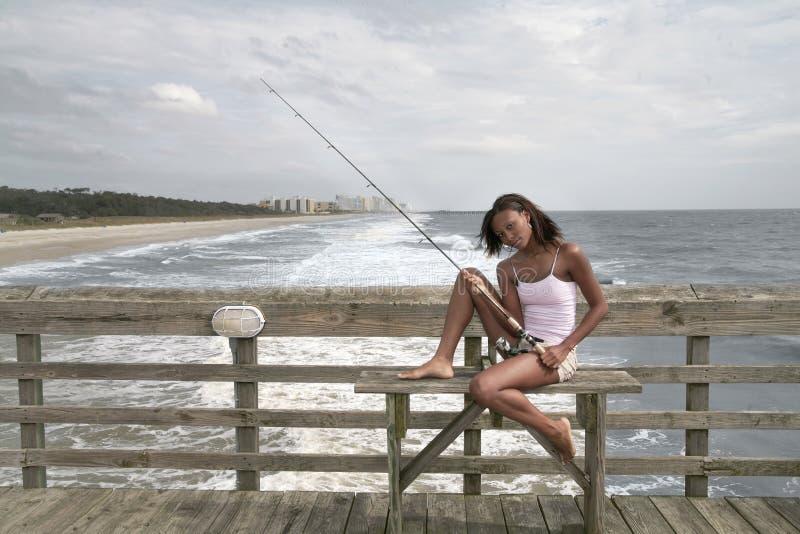 捕鱼码头妇女 图库摄影