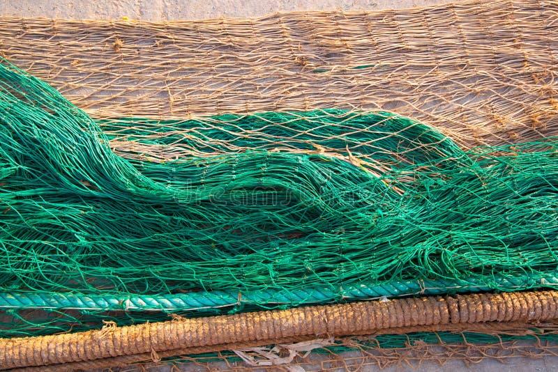 捕鱼网在土壤的纹理样式 库存图片