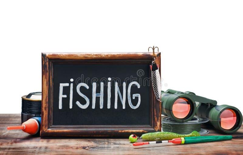 捕鱼装置和黑板 库存图片