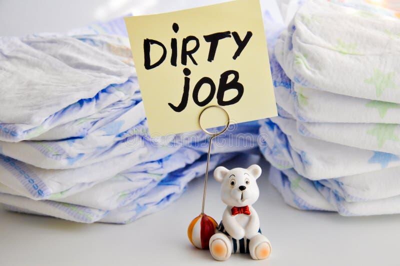 换尿布是一个肮脏的工作 免版税图库摄影