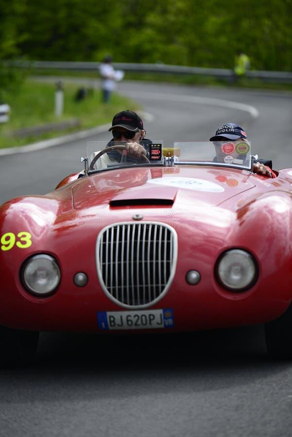 捷豹汽车运行在Mille Miglia种族的Biondetti汽车 库存图片